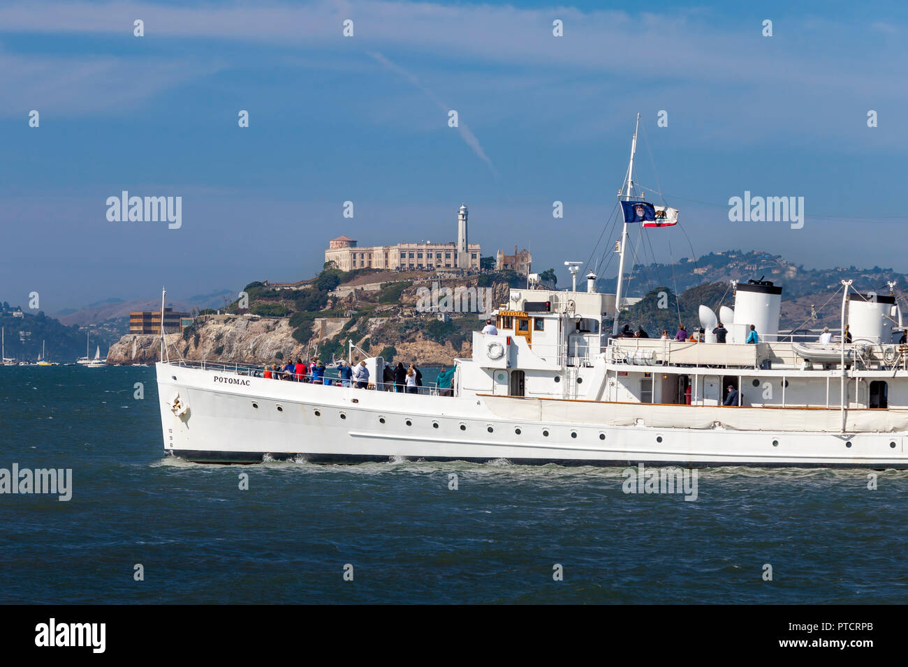 USS Potomac (AG-25) - Franklin Delano Roosevelt's yacht, launched 1934, sails past Alcatraz Prison in San Francisco Bay, California, USA - Stock Image