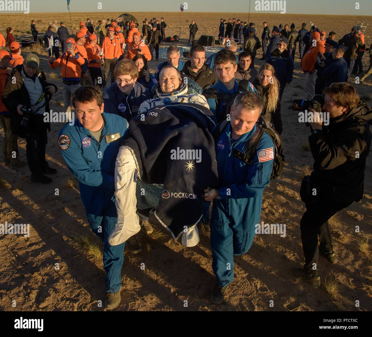 International Space Station Expedition 56 astronaut Ricky Arnold is carried to the medical tent shortly after landing aboard the Russian Soyuz MS-08 spacecraft October 4, 2018 near Zhezkazgan, Kazakhstan. - Stock Image