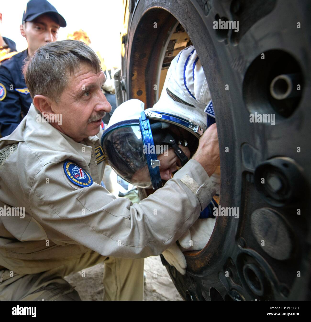 International Space Station Expedition 56 astronaut Drew Feustel is helped out from the Russian Soyuz MS-08 spacecraft shortly after landing October 4, 2018 near Zhezkazgan, Kazakhstan. - Stock Image