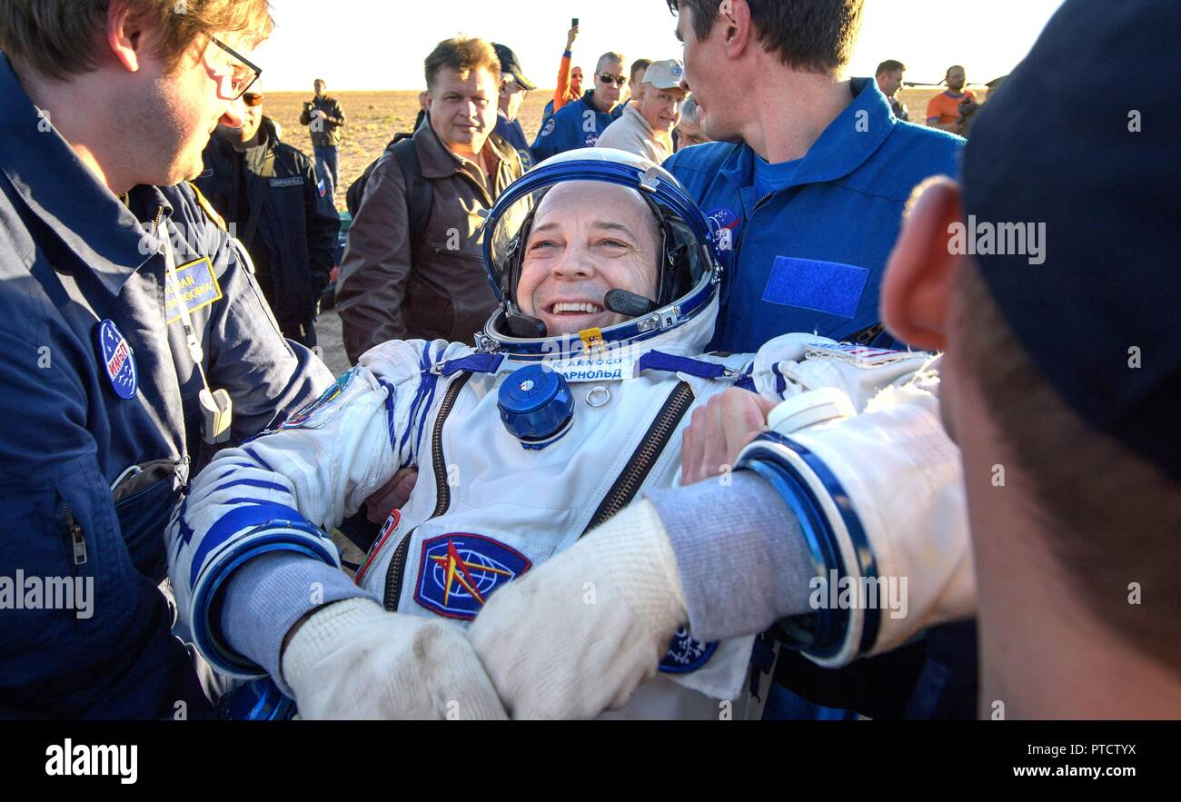 International Space Station Expedition 56 astronaut Ricky Arnold is helped out from the Russian Soyuz MS-08 spacecraft shortly after landing October 4, 2018 near Zhezkazgan, Kazakhstan. - Stock Image