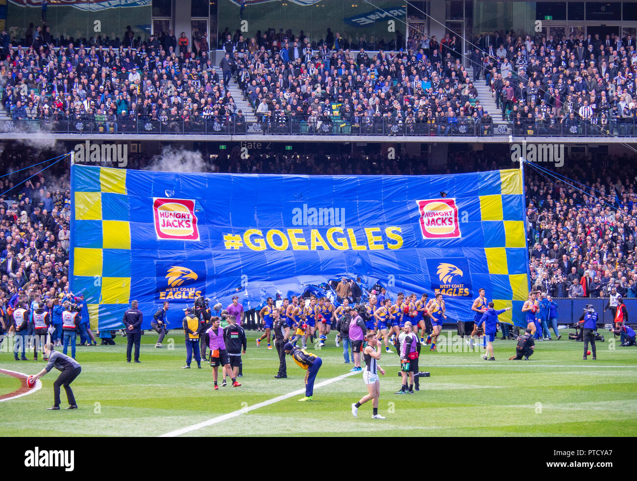 West Coast Eagles Football club footballers running through banner at 2018 AFL Grand Final at MCG Melbourne Victoria Australia. - Stock Image