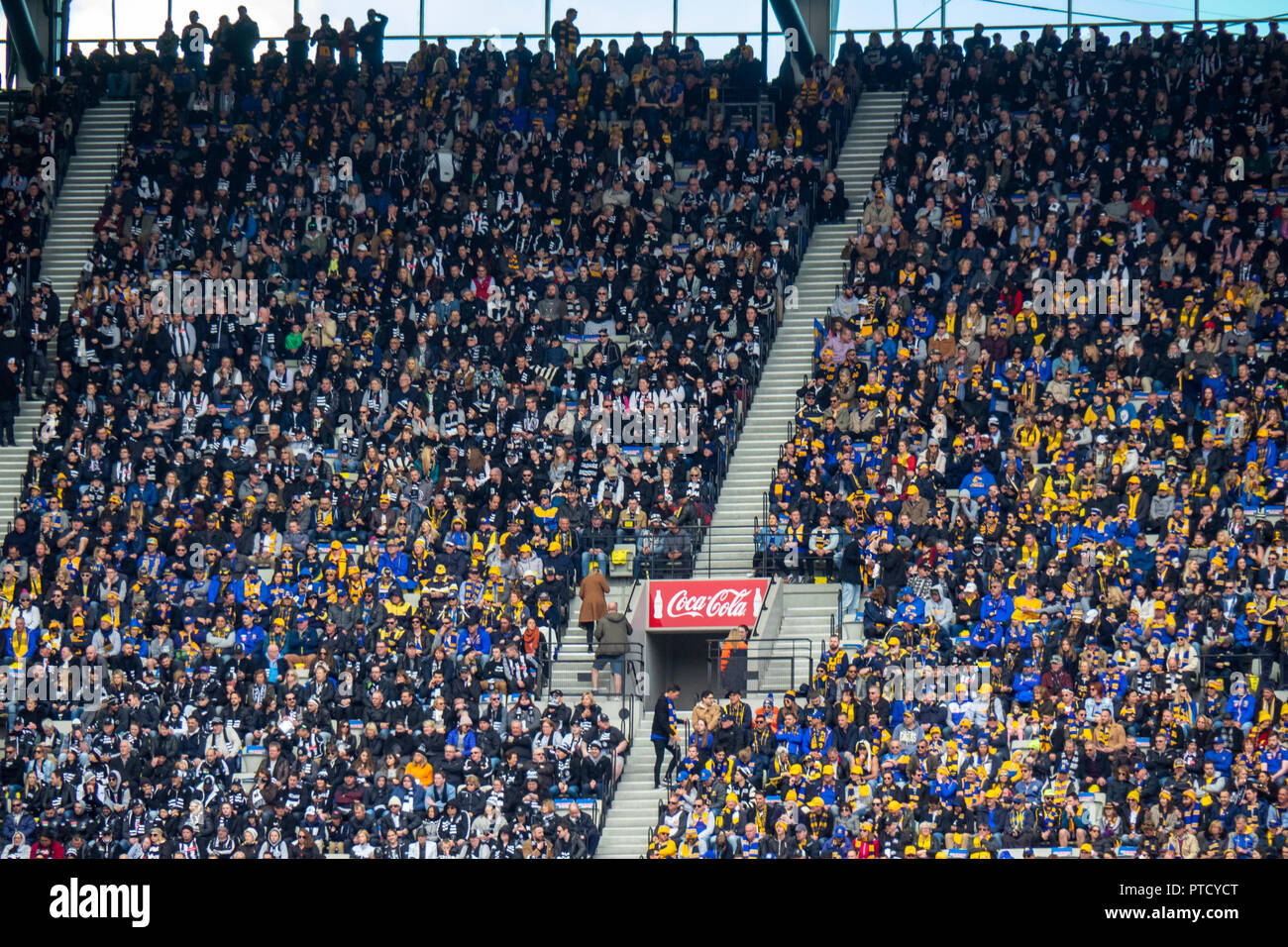West Coast Eagles and Collingwood fans and supporters in their seats at 2018 AFL Grand Final at MCG Melbourne Victoria Australia. - Stock Image