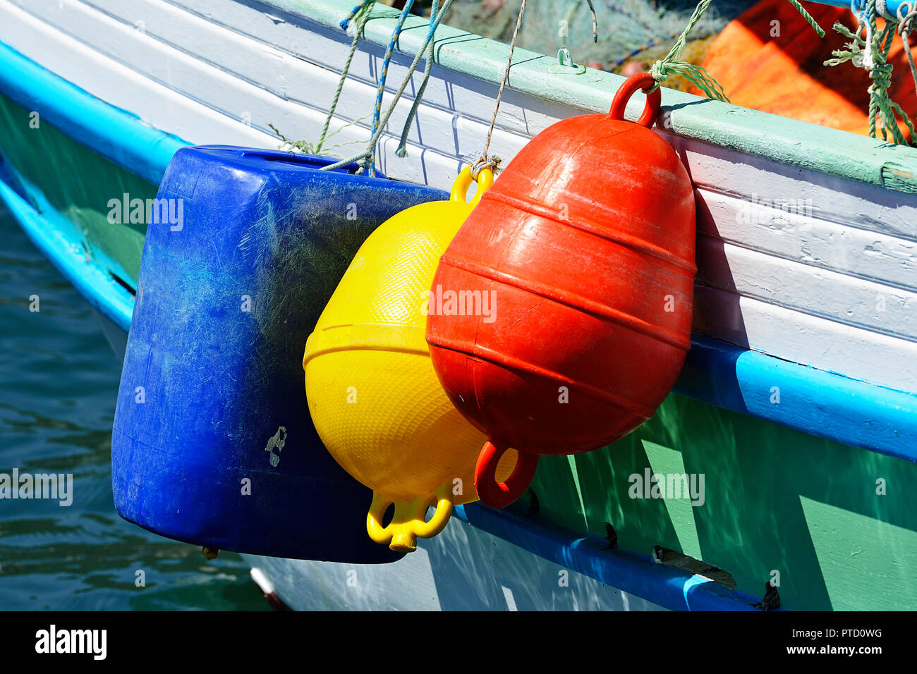 Fishing boat with colourful buoys, detail, impact protection, Elounda, Crete, Greece - Stock Image