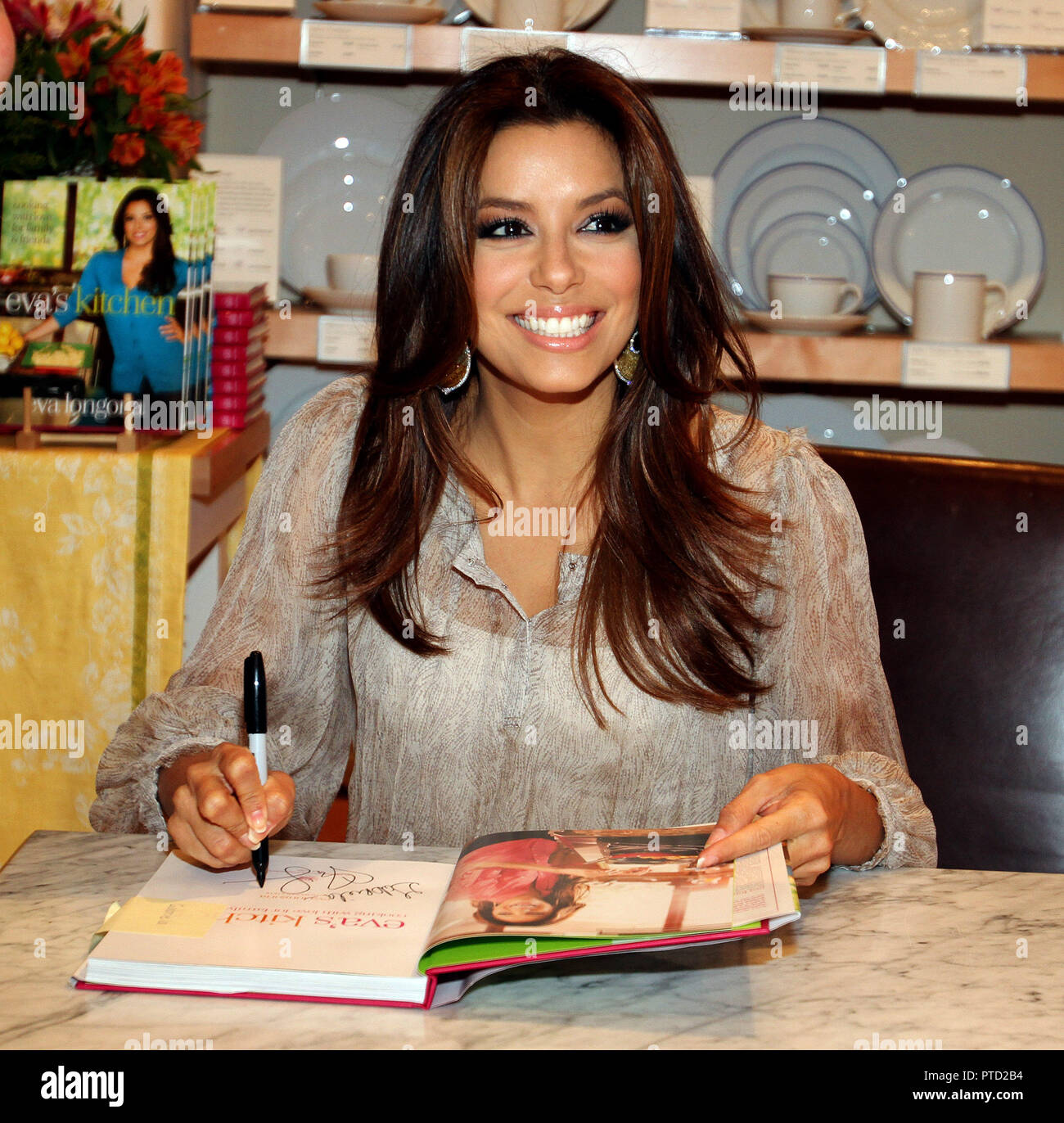Eva Longoria Sign Books During An Event To Promote Her