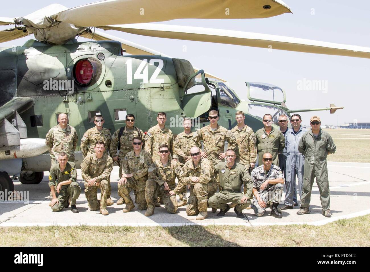 Aviators from A Company, 2-10 Assault Helicopter Battalion, pose with pilots from the Bulgarian Air Force after a successful combat search and rescue training in Plovdiv, Bulgaria, on July 11. The Aviators worked together in planning and executing the training to build interoperability during Saber Guardian 17. Stock Photo