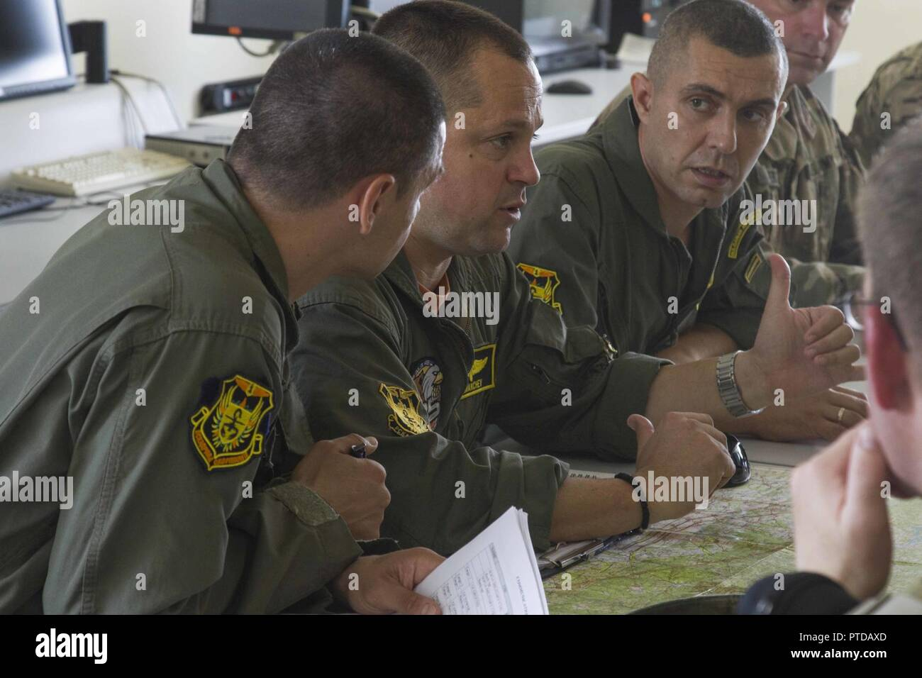 Bulgarian Air Force pilots help to plan an upcoming combat search and rescue mission as part of exercise Saber Guardian 17 at Plovdiv, Bulgaria, on July 10. By synchronizing each other's communications systems, flight patterns, and answering questions, a deeper level of understanding is reached by each side and interoperability between NATO Allies is acheived. Stock Photo