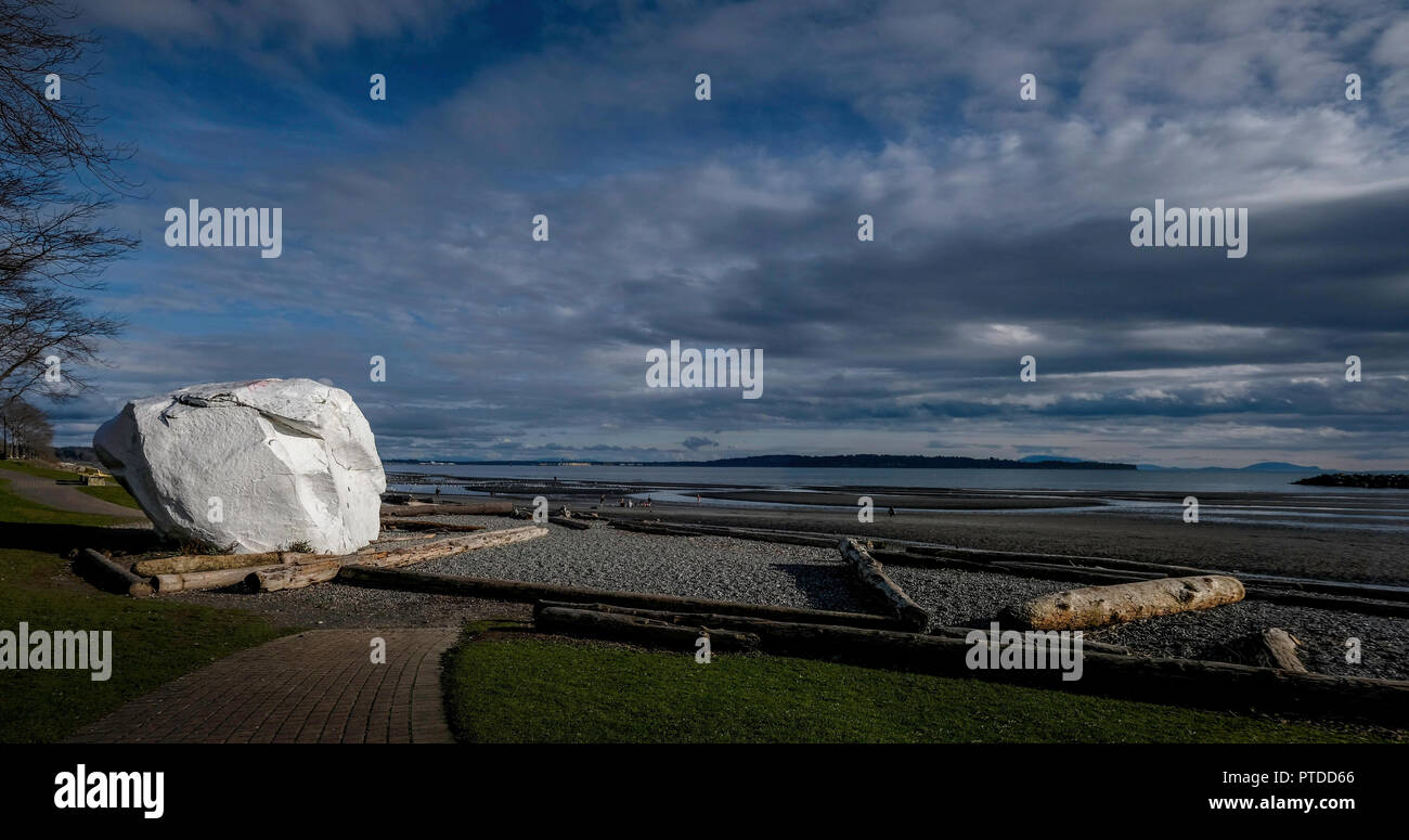 A HUGE white rock, stoic and strong, on the beach of White Rock - Stock Image