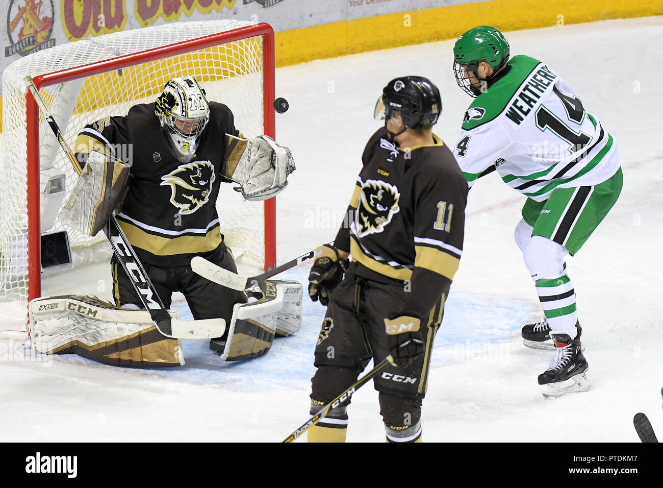 October 6, 2018 North Dakota Fighting Hawks forward Jasper Weatherby (14) hits the post next to Manitoba Bisons goaltender Byron Spriggs (35) as Manitoba Bisons defenseman Mitchell Dyck (11) looks on in the third period of an exhibition men's college hockey game between the Manitoba Bisons and the University of North Dakota Fighting Hawks at Ralph Engelstad Arena in Grand Forks. North Dakota won 3-2 in overtime. Photo by Russell Hons/CSM - Stock Image