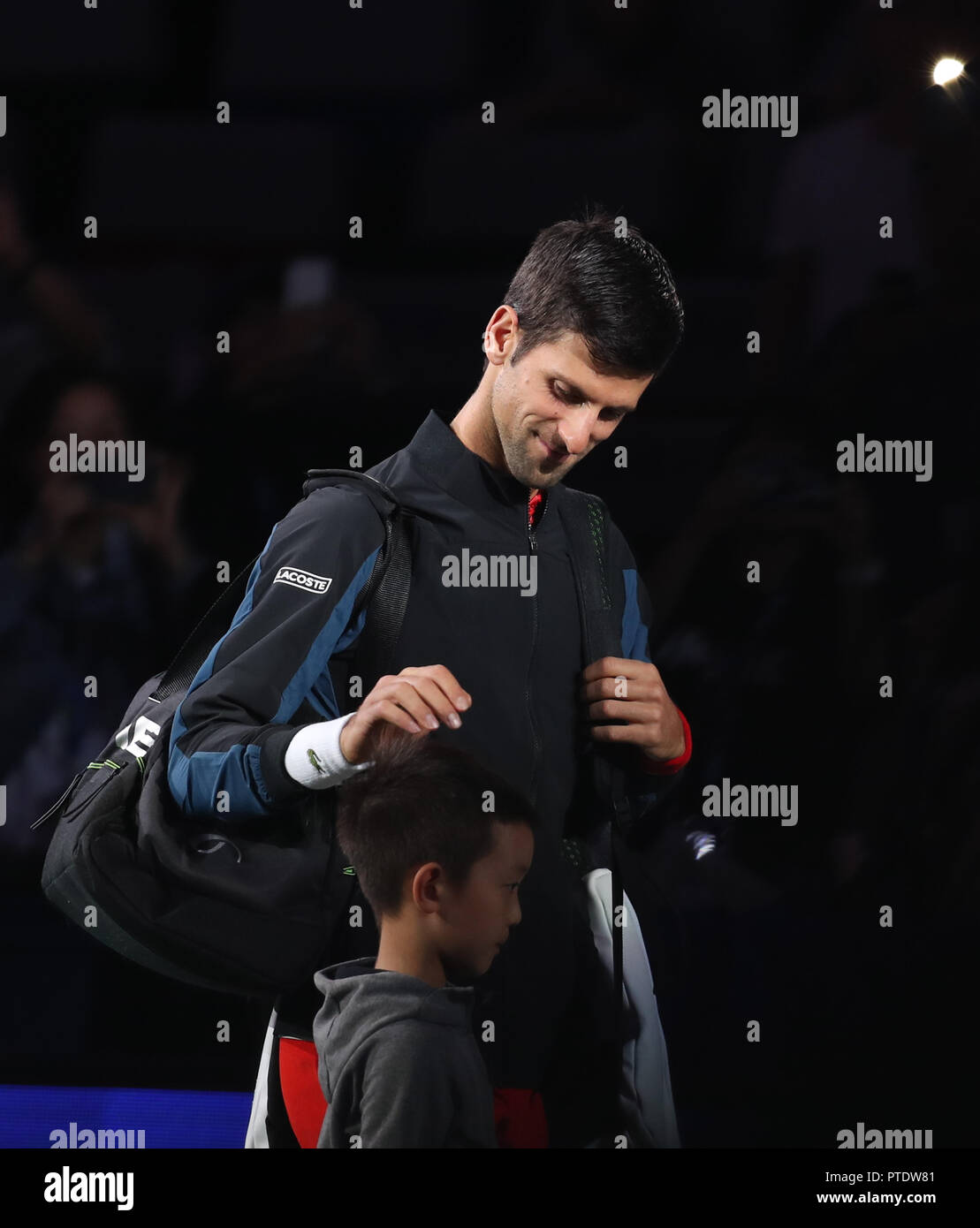 Shanghai. 9th Oct, 2018. Serbia's Novak Djokovic enters the court ahead of the men's singles second round match against France's Jeremy Chardy at the Shanghai Masters tennis tournament on Oct. 9, 2018. Novak Djokovic won 2-0. Credit: Ding Ting/Xinhua/Alamy Live News - Stock Image