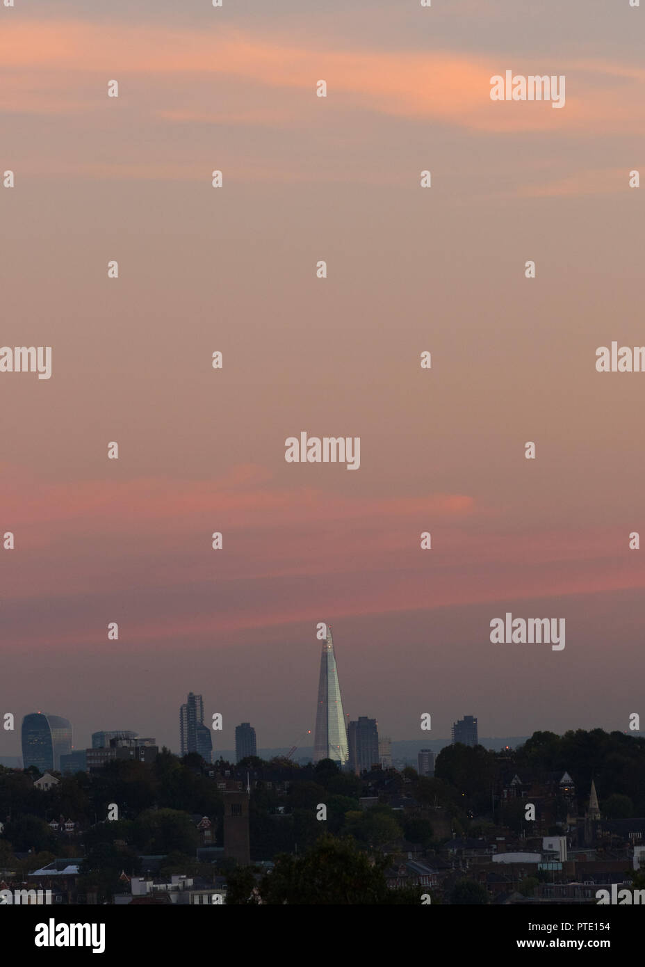 Alexandra Palace, London UK. Tuesday 9th October 2018. UK Weather, pink skies over London during sunset.London skyline with shard. Credit: carol moir/Alamy Live News Stock Photo
