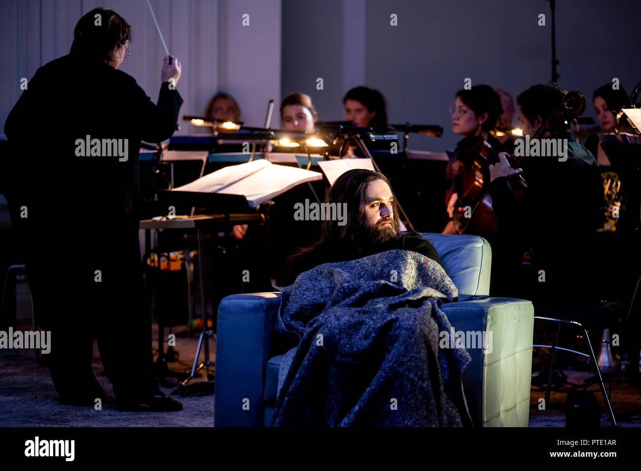09 October 2018, Berlin: David O·trek appears in the role of Roderick Usher at the photo rehearsal for the premiere of 'Usher' by Claude Debussy and Annelies Van Parys in the production of Philippe Quesne at the Staatsoper Unter den Linden. Photo: Christoph Soeder/dpa - Stock Image