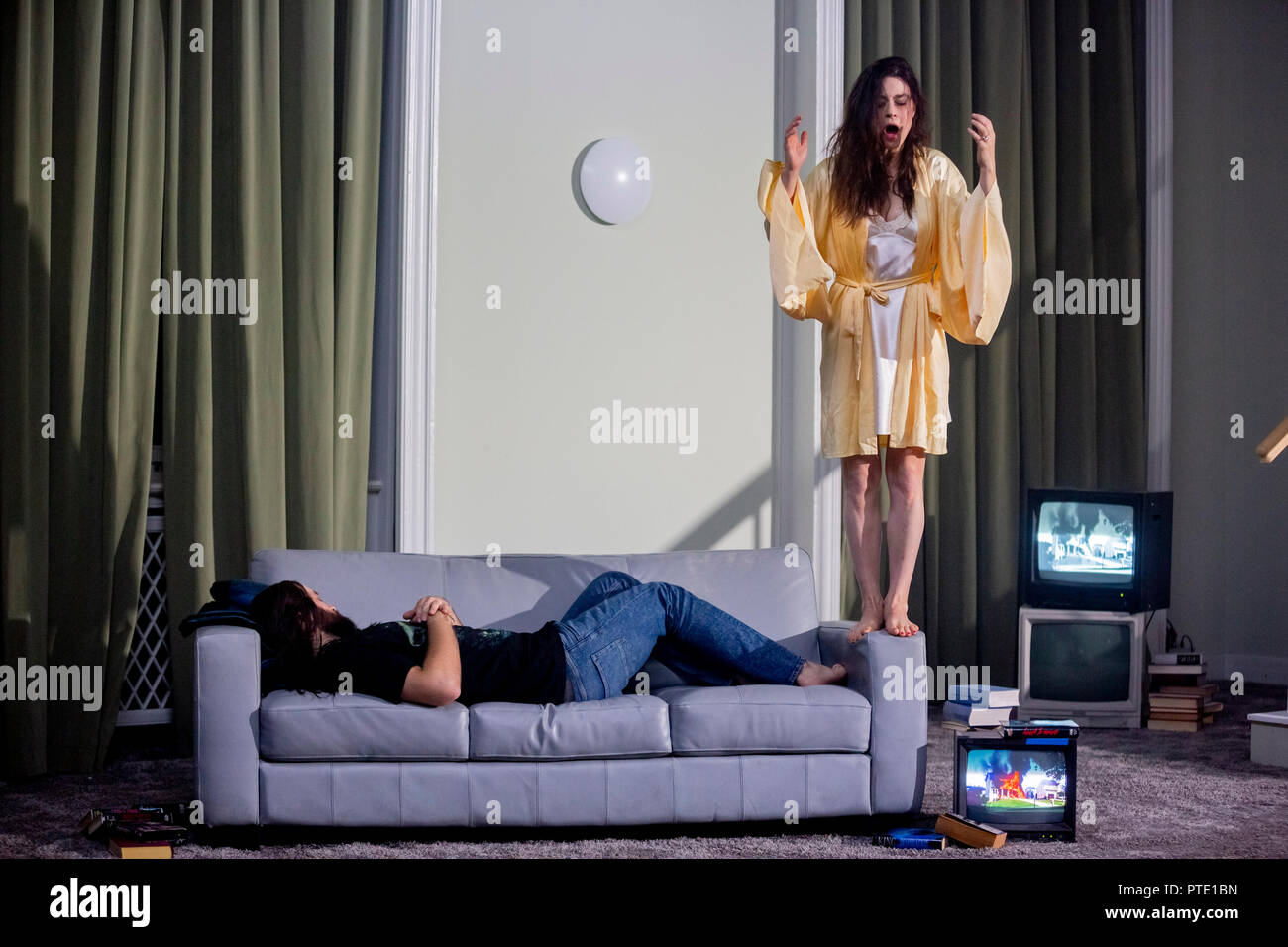09 October 2018, Berlin: David O·trek in the role of Roderick Usher (l) and Ruth Rosenfeld in the role of Lady Madeline appear in the photo rehearsal for the premiere of 'Usher' by Claude Debussy and Annelies Van Parys in the production of Philippe Quesne at the Staatsoper Unter den Linden. Photo: Christoph Soeder/dpa - Stock Image