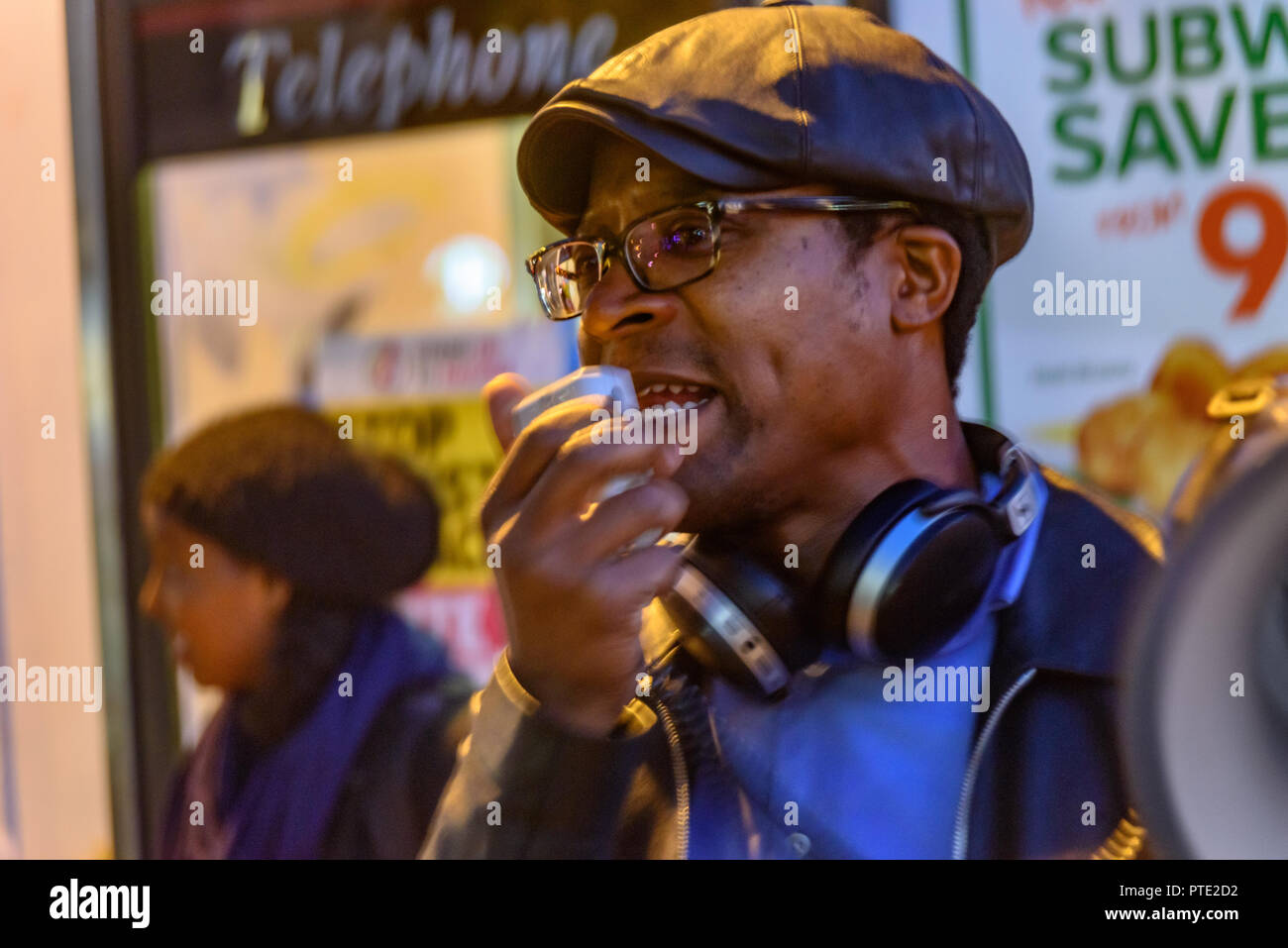 London, UK. October 9th 2018. Brian Richardson of Stand Up To Racism makes the final speech at the rally outside the New Atlas Cafe Restaurant where a young black man was attacked by police who used obviously unnecessary force when arresting him on suspicion of having been involved in a knife attack. He was assaulted by six officers, and was viciously kicked while officers struggled to handcuff him, andwhen he was well under control and held on the ground he was sprayed in the face with CS gas. Credit: Peter Marshall/Alamy Live NewsStock Photo