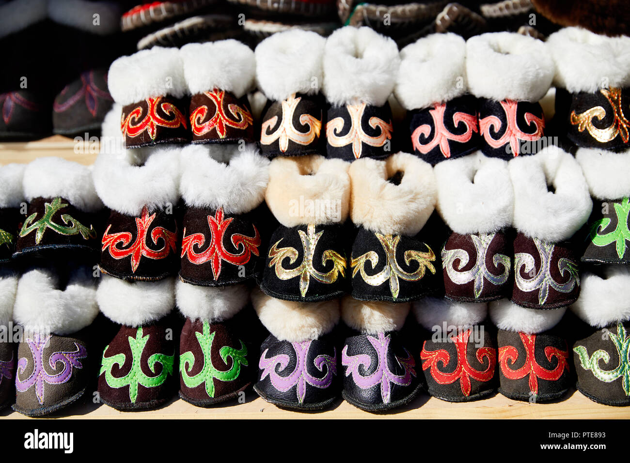 Various of ethnic shoes with Kazakh traditional pattern street market in Almaty, Kazakhstan - Stock Image