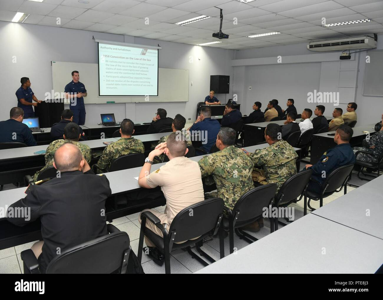 Peru (July 16, 2917) - U.S. Coast Guard Lt. Andrew Ray conducts a maritime law enforcement symposium with UNITAS partner nation participants from Mexico, Peru, Honduras and Chile. UNITAS is an annual exercise that focuses on strengthening our existing regional partnerships and encourages establishing new relationships through the exchange of maritime mission-focused knowledge and expertise throughout the exercise. Stock Photo