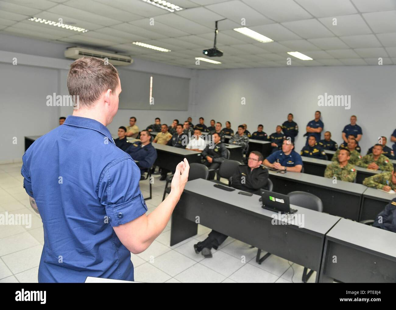 Peru (July 16, 2917) - U.S. Coast Guard Lt. Andrew Ray conducts a maritime law enforcement symposium with UNITAS partner nation participants from Mexico, Peru, Honduras and Chile. UNITAS is an annual exercise that focuses on strengthening our existing regional partnerships and encourages establishing new relationships through the exchange of maritime mission-focused knowledge and expertise throughout the exercise. - Stock Image