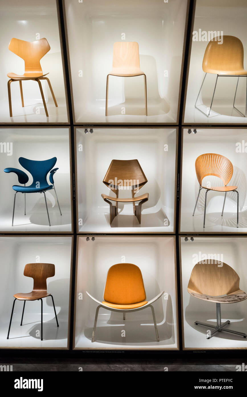 Copenhagen. Denmark. Danish Museum of Art & Design. Display of iconic Danish chairs, centre, GJ Bow Chair, 1963, designed by Grete Jalk (1920-2006). - Stock Image