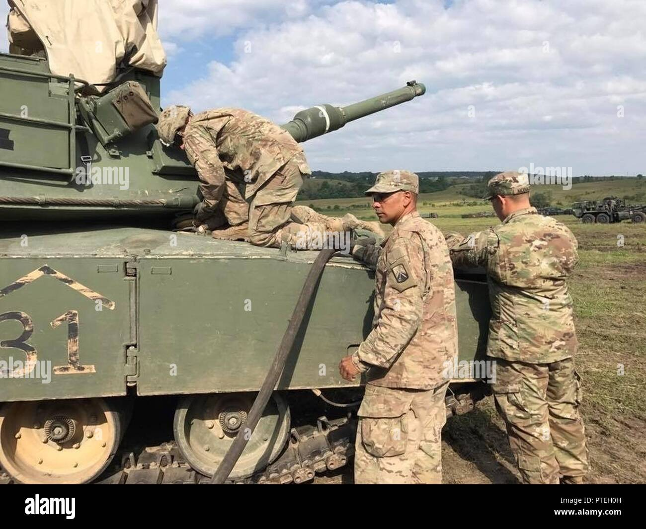 Sgt Cruz Cotto A Motor Transport Operator With 515th Transportation Company Uses The Retail Fuel Hose Of The M969 5 000 Gallon Fuel Tanker To Refuel An M1 Abrams Tank In Cincu Romania