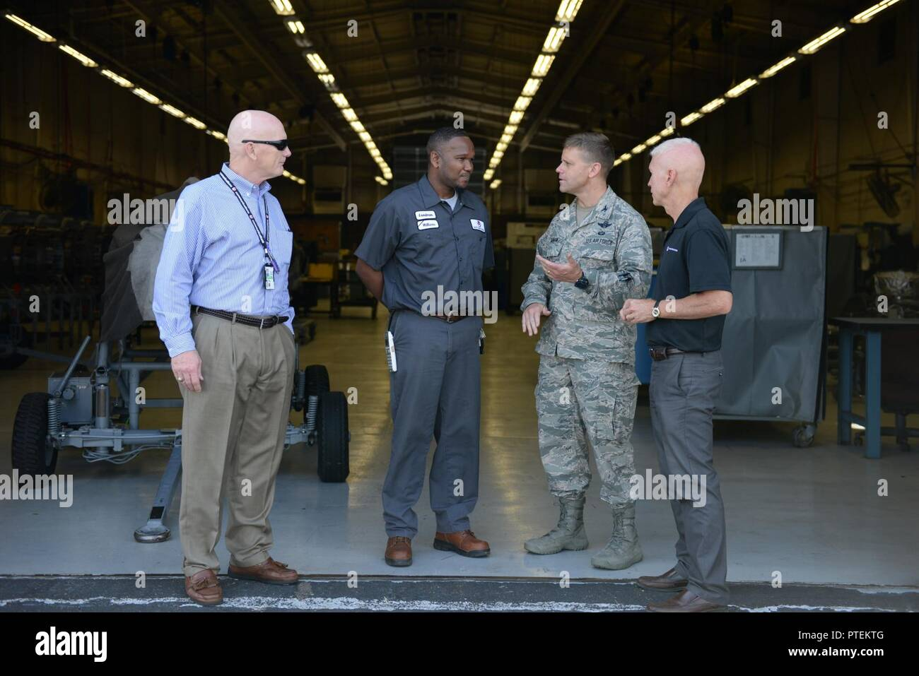 Col. William Denham, 14th Flying Training Wing Vice Commander, speaks with the L3 contracted maintainers July 17, 2017, on Columbus Air Force Base, Mississippi. The maintainers on Columbus AFB are contracted out and are a large part of the Columbus AFB community. - Stock Image