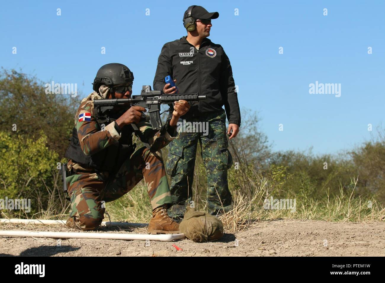 A Dominican competitor fires his weapon down range in the Critical Task Evaluation 2 event of the Fuerzas Comando competition July 18, 2017 at Vista Alegre in Presidente Hayes, Paraguay. The competition increases the sharing of expertise among the region's highly-skilled special operation forces. Stock Photo
