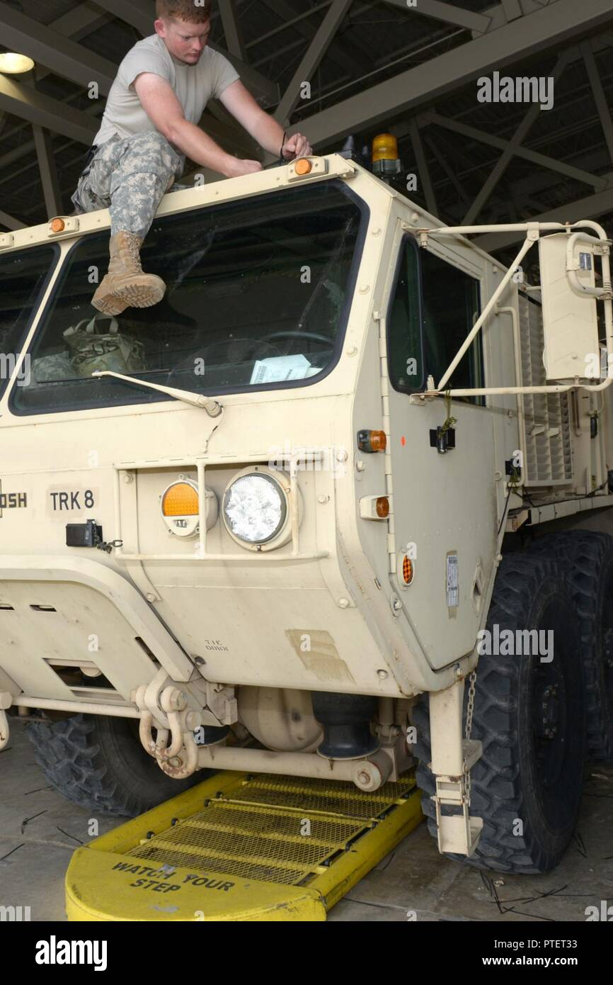 Indiana National Guard Spc Joseph Long From Madison Indiana And A 1438th Transportation Company Truck Driver Installs A Transmitter Onto A Tactical Truck At The Fort Polk Louisiana Railhead Tuesday July 18