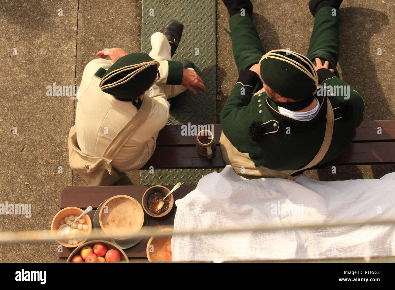 Filming overhead  POV- Rifleman Diaries- Two riflemen seated in period military costume sit chatting. - Stock Image