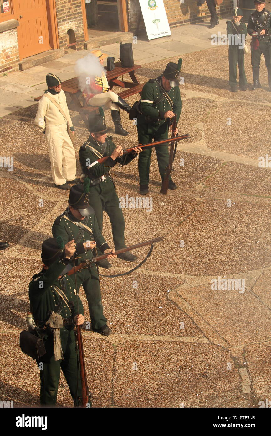 Filming overhead  POV- Rifleman Diaries- Riflemen at a re-enactment taking aim and firing. - Stock Image