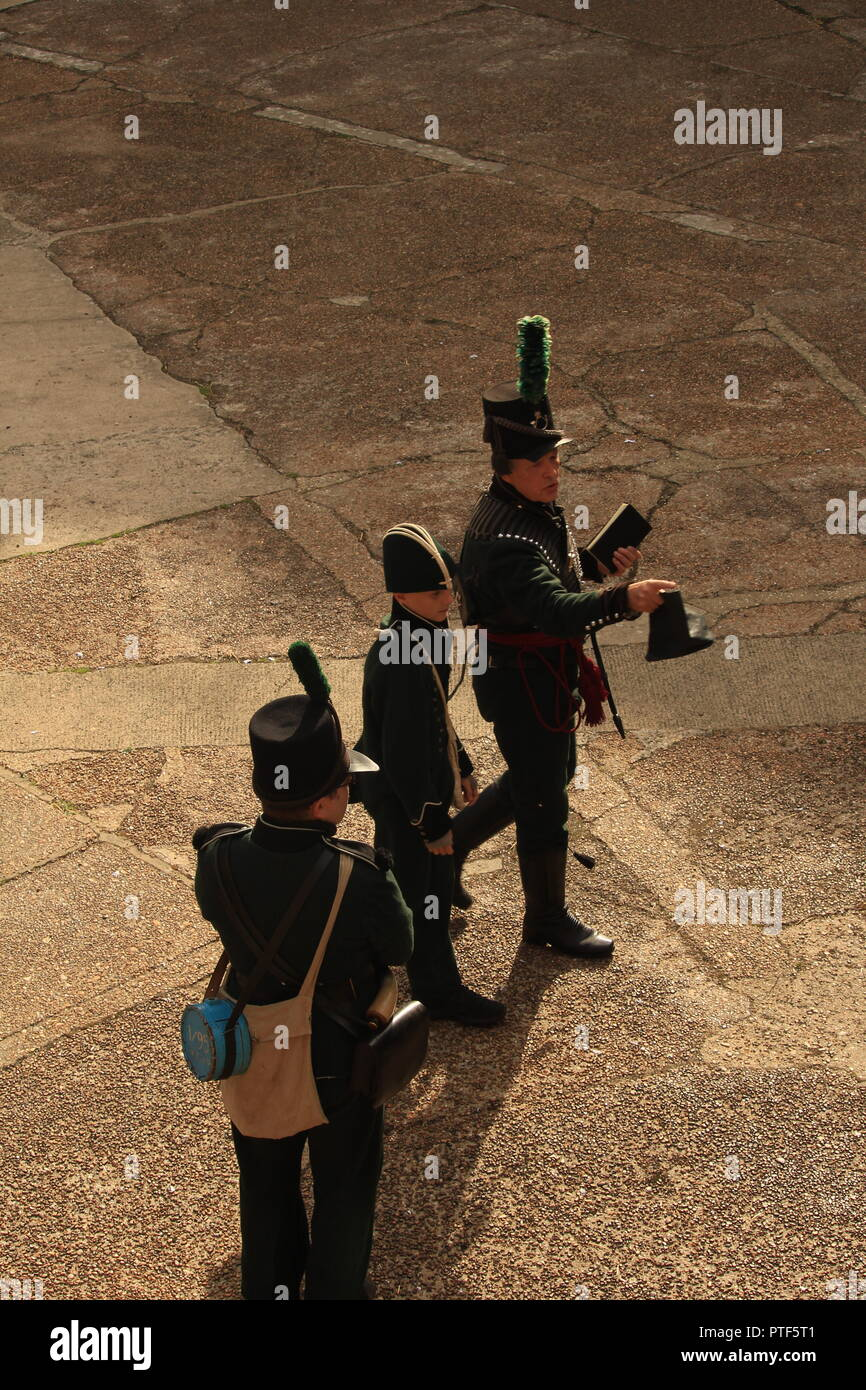Filming overhead  side-shot POV- Rifleman Diaries- Group of three Riflemen at a re-enactment. - Stock Image