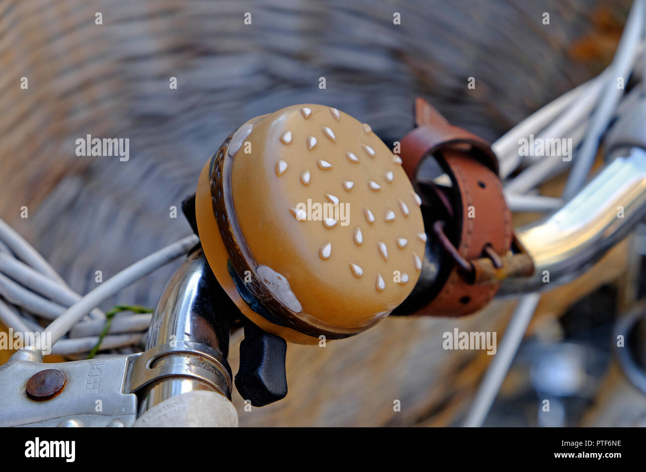 burger style bicycle bell on cycle handlebars - Stock Image