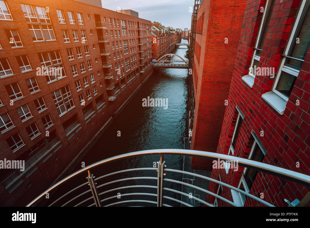 Top view of Warehouse District from canal side with red brick buildings of Speicherstadt in Hamburg during sunset Stock Photo
