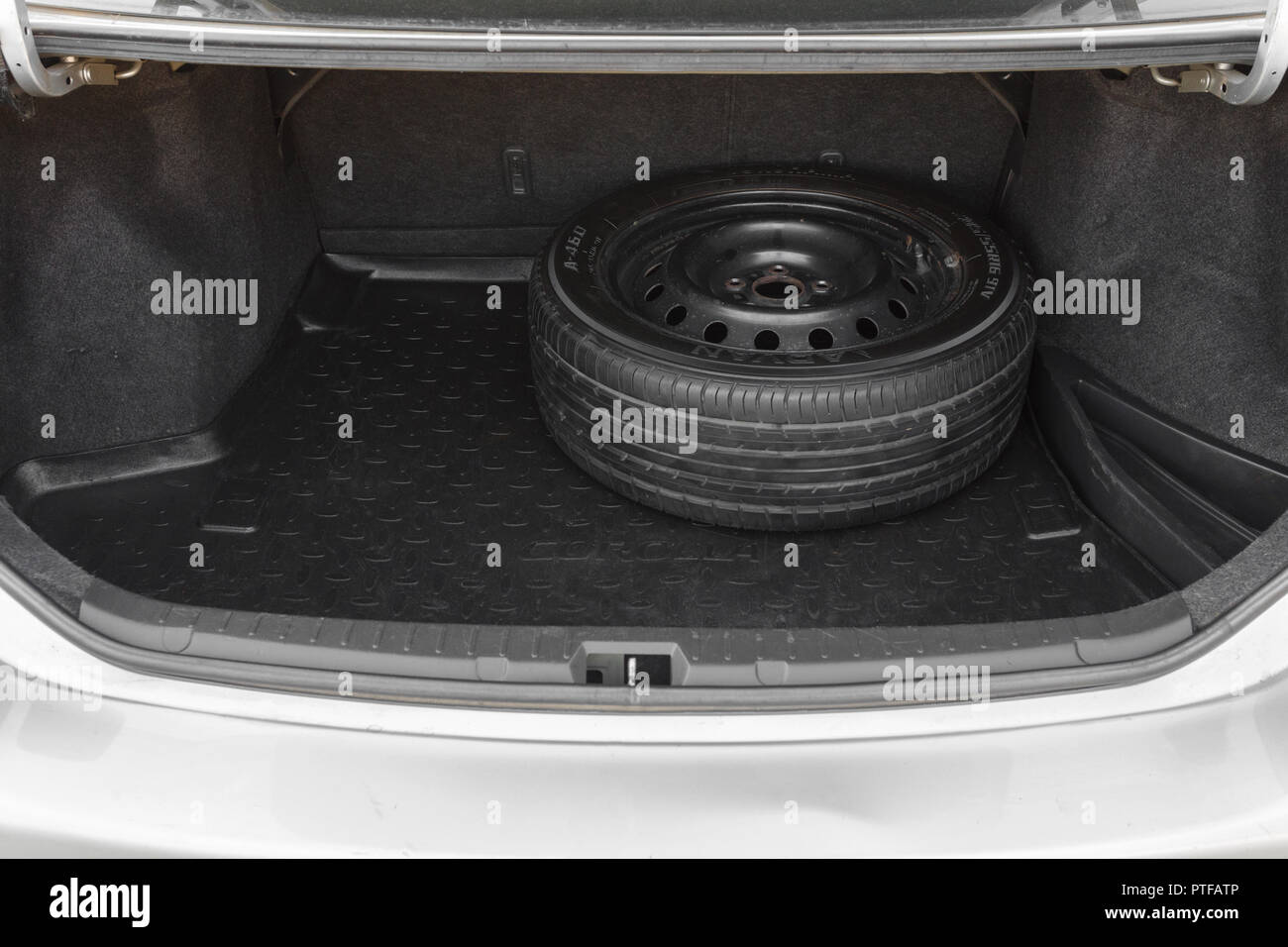 DNIPRO, UKRAINE - SEPTEMBER 01, 2018: TOYOTA COROLLA GREY COLOR, SPARE WHEEL IN THE TRUNK - Stock Image