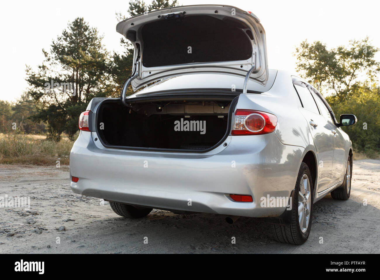 DNIPRO, UKRAINE - SEPTEMBER 01, 2018: TOYOTA COROLLA PARKED IN THE FOREST, TRAVEL STOP, OPEN TRUNK - Stock Image