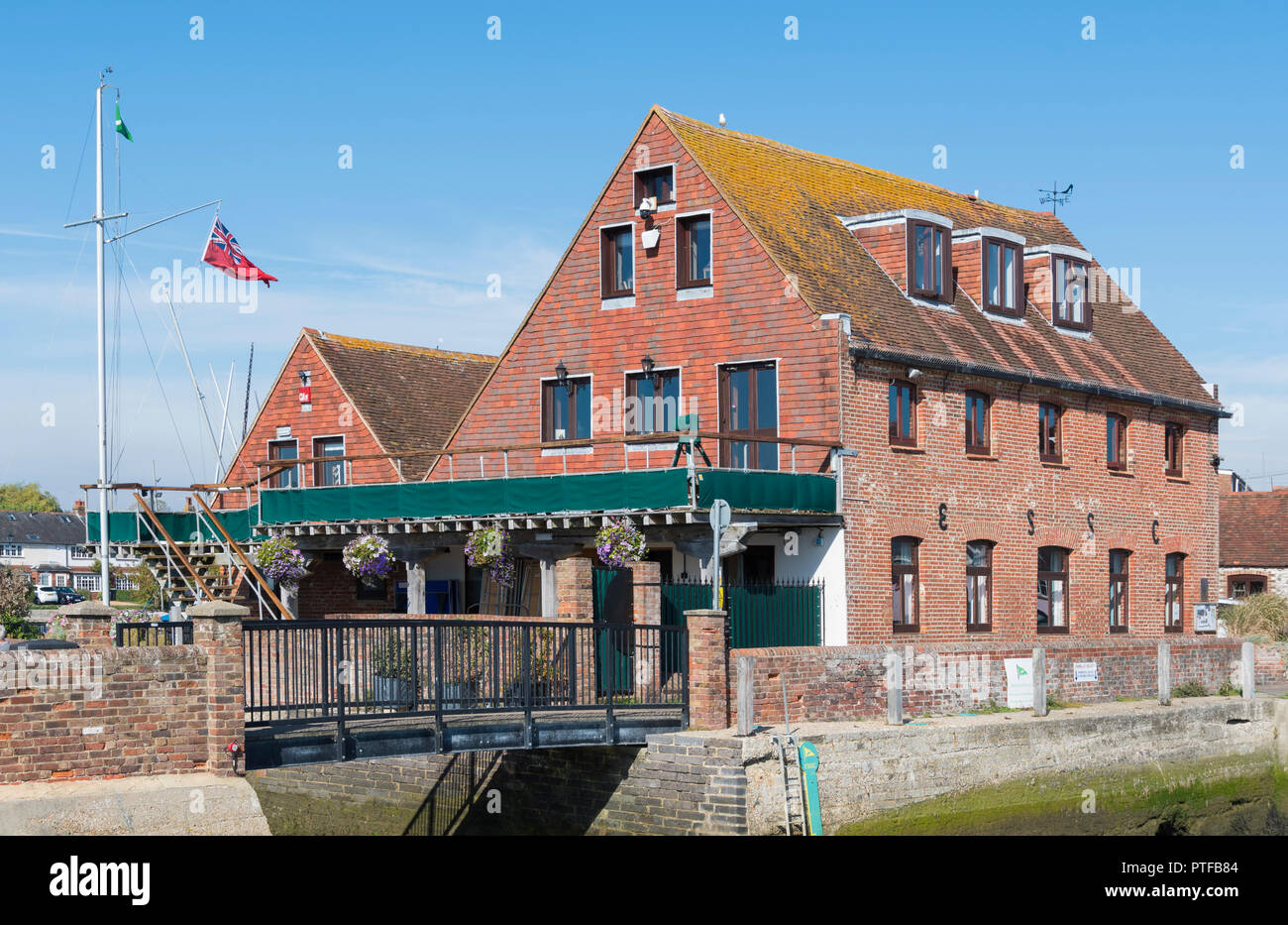 Emsworth Slipper Sailing Club (ESSC) at the Old Quay Tide Mill building in Emsworth, Hampshire, England, UK. - Stock Image