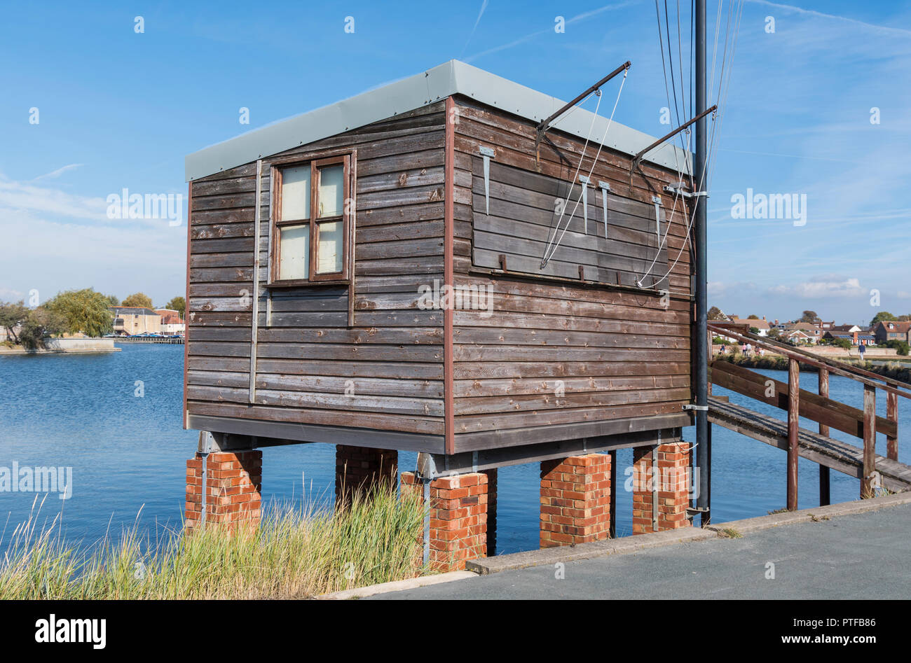 Sailing club boat race hut, a wooden hut on brick pillars in Slipper Mill Pond in Emsworth, Hampshire, England, UK. - Stock Image