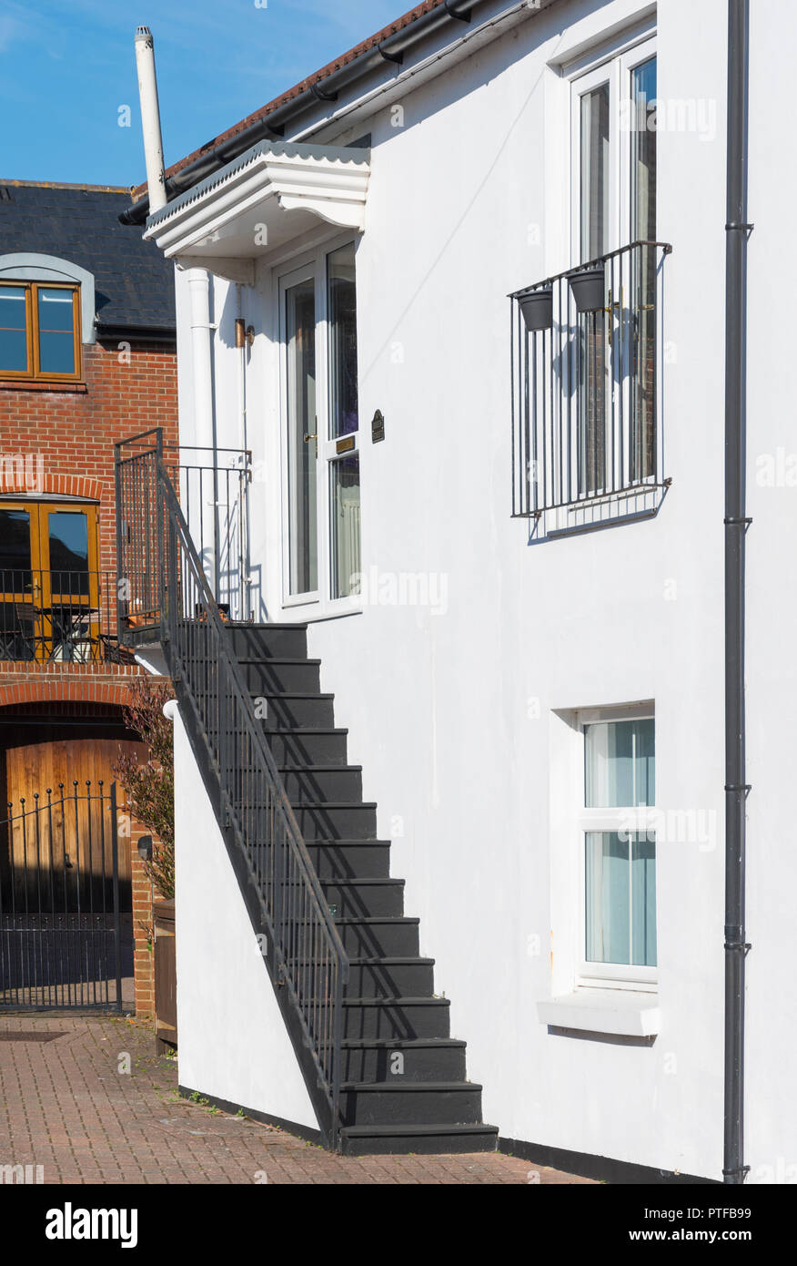 Stairs to side entrance door of a house in Emsworth, Hampshire, England, UK. - Stock Image