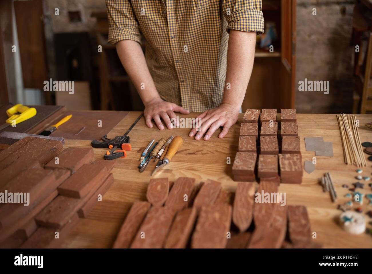 Close-up view of a wood carpenter's hands - Stock Image
