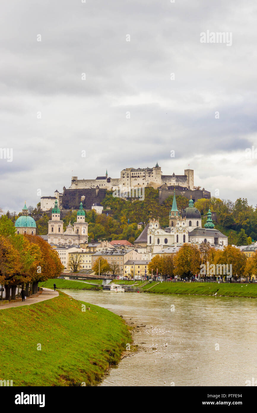 Famous classic view of historic old  city of Salzburg  with Festung Hohensalzburg. View of Salzburg over Salzach river on a cloudy autumn day. Salzbur - Stock Image