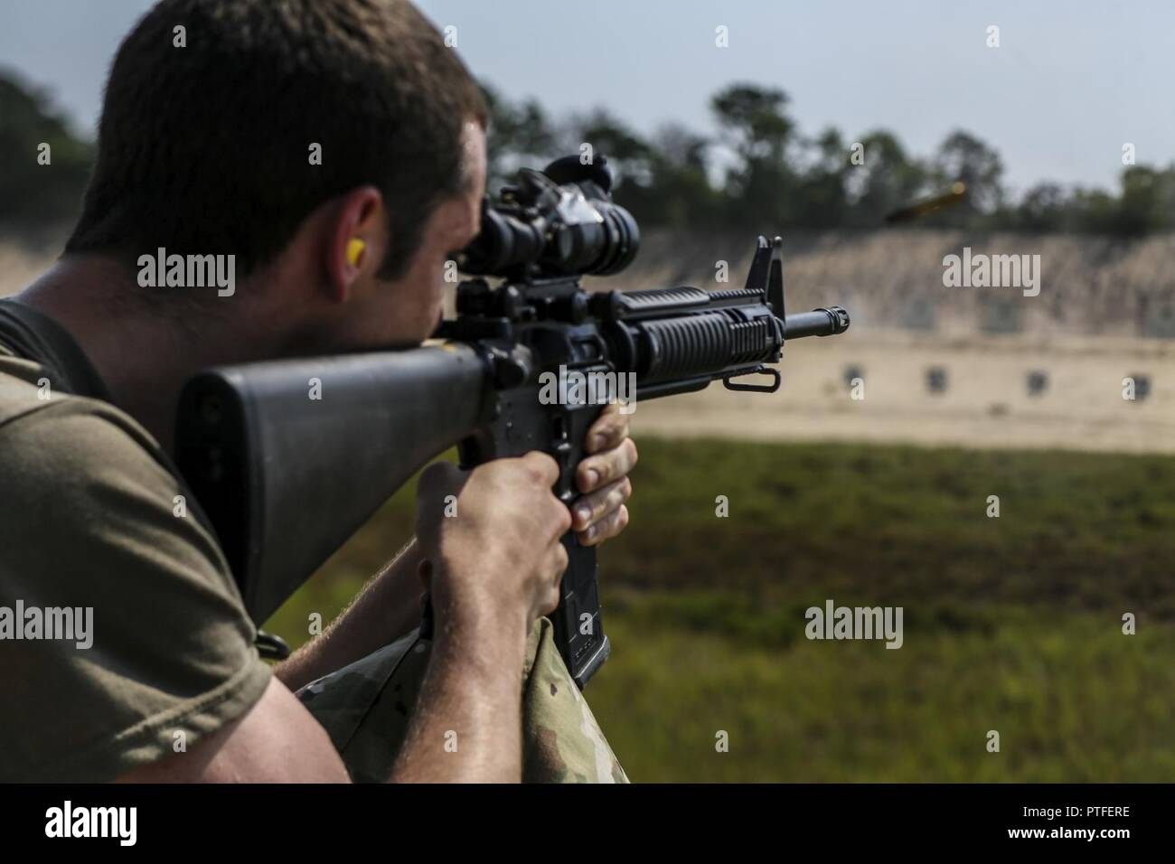 A U S Army Soldier Fires An M16a4 Rifle During The Squad Designated