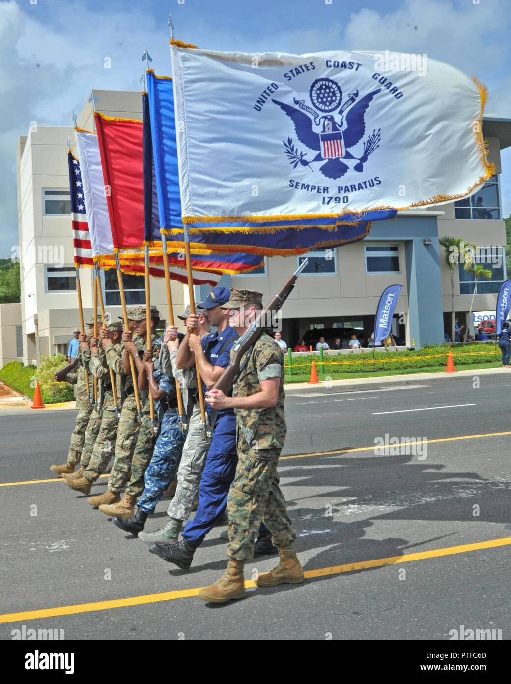 Guam (July 21, 2017) A joint- service color guard parades the colors during Guam's annual Liberation Day Parade in Hagatna, Guam, July 21. The 2017 Guam Liberation Parade celebrates the 73rd anniversary of the liberation of Guam from Japanese occupation by U.S. forces during World War II. - Stock Image