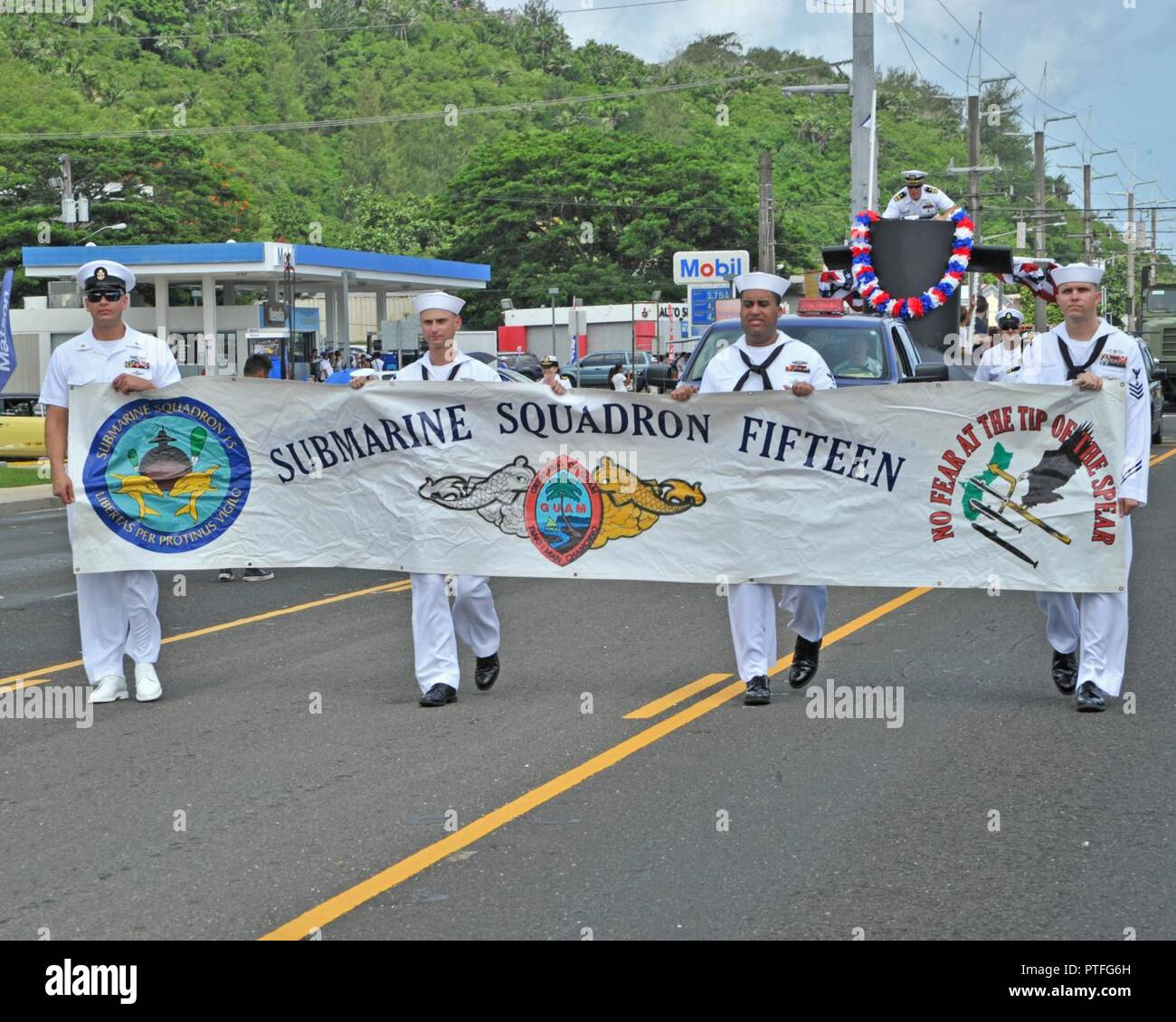 Guam (July 21, 2017) Sailors from Commander, Submarine Squadron 15 carry a banner during Guam's annual Liberation Day Parade in Hagatna, Guam, July 21. The 2017 Guam Liberation Parade celebrates the 73rd anniversary of the liberation of Guam from Japanese occupation by U.S. forces during World War II. - Stock Image
