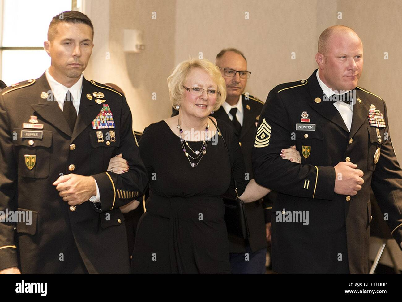 Nita Cross of Galesburg, Illinois, mother of fallen Illinois Army National  Guard Soldier Sgt. 1st Class Kyle Wehrly, is escorted to her seat by 1st  Sgt. ...