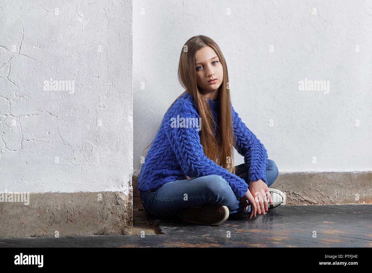 53b2b2958b49 Girl near wall. Stylish girl hipster teen Stock Photo  221620042 - Alamy