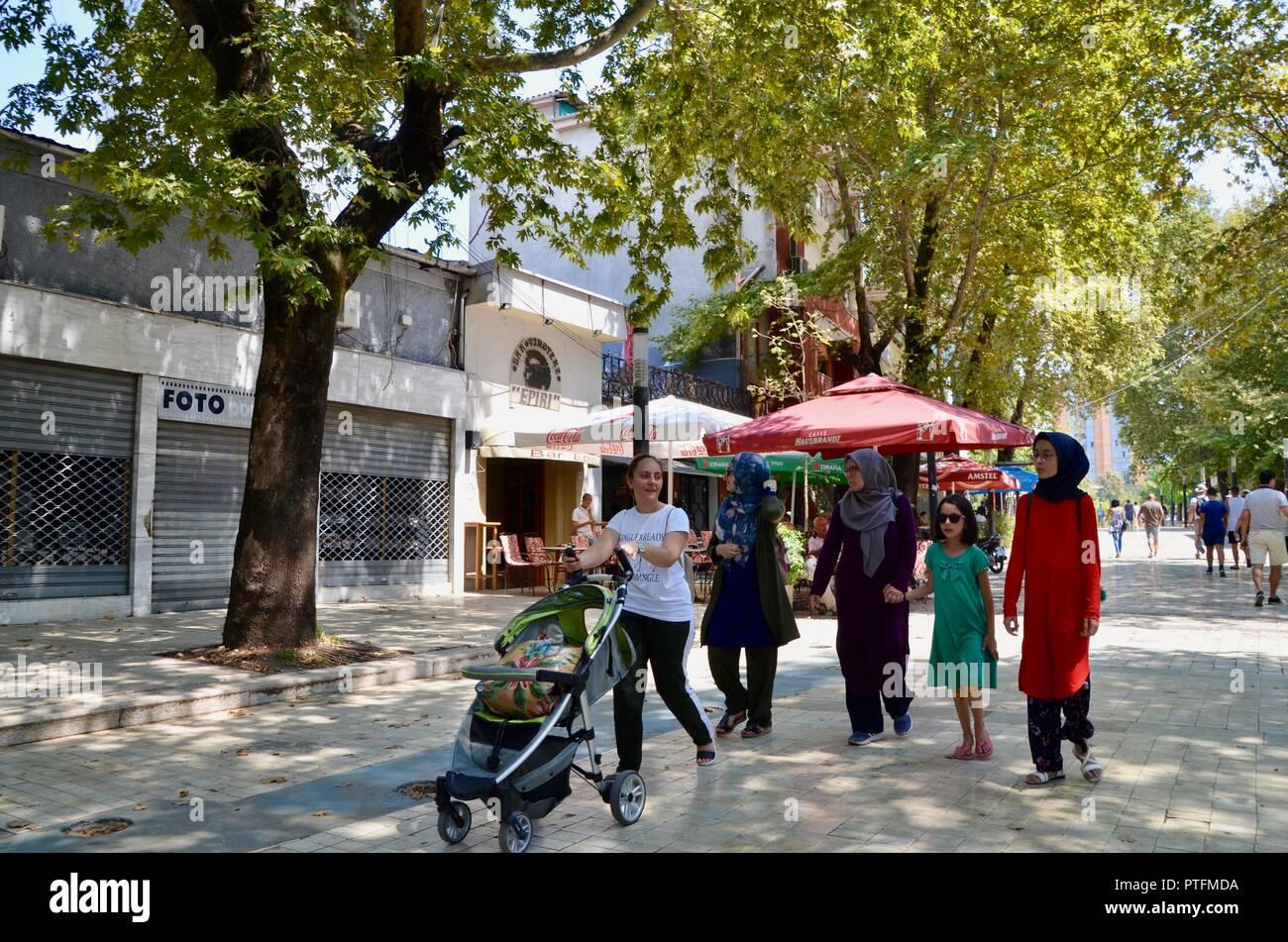 an islamic muslim family walk through central tirana albania - Stock Image