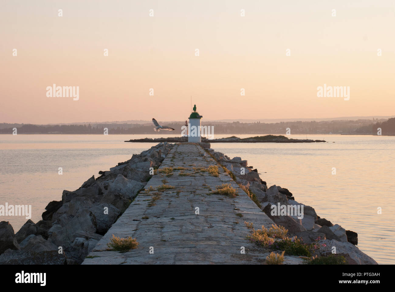 Early mornig pier walk towards the lighthouse - Stock Image