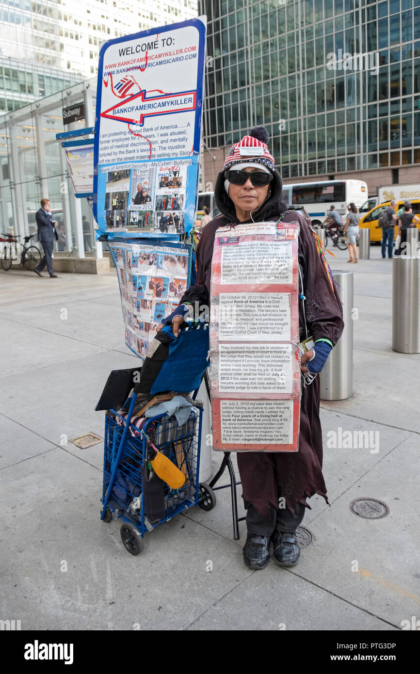 A woman demonstrating against the Bank of America outside of the B of A building on 42nd St. & 6th Avenue in Manhattan, New York City. - Stock Image