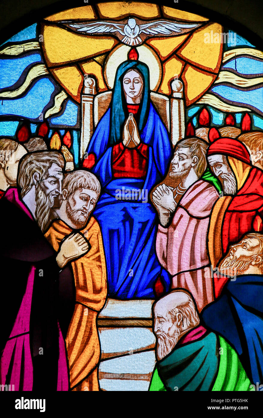 Stained glass window depicting Mother Mary and the Disciples of Christ at Pentecost in the Church of Ostuni, Apulia, Italy. - Stock Image