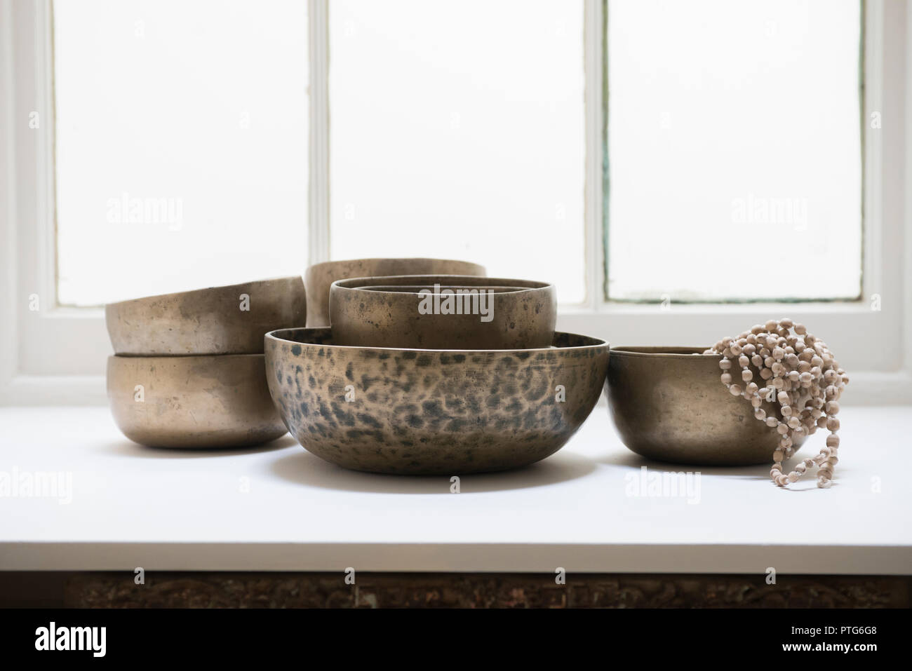Tibetan singing bowls interior feature Stock Photo