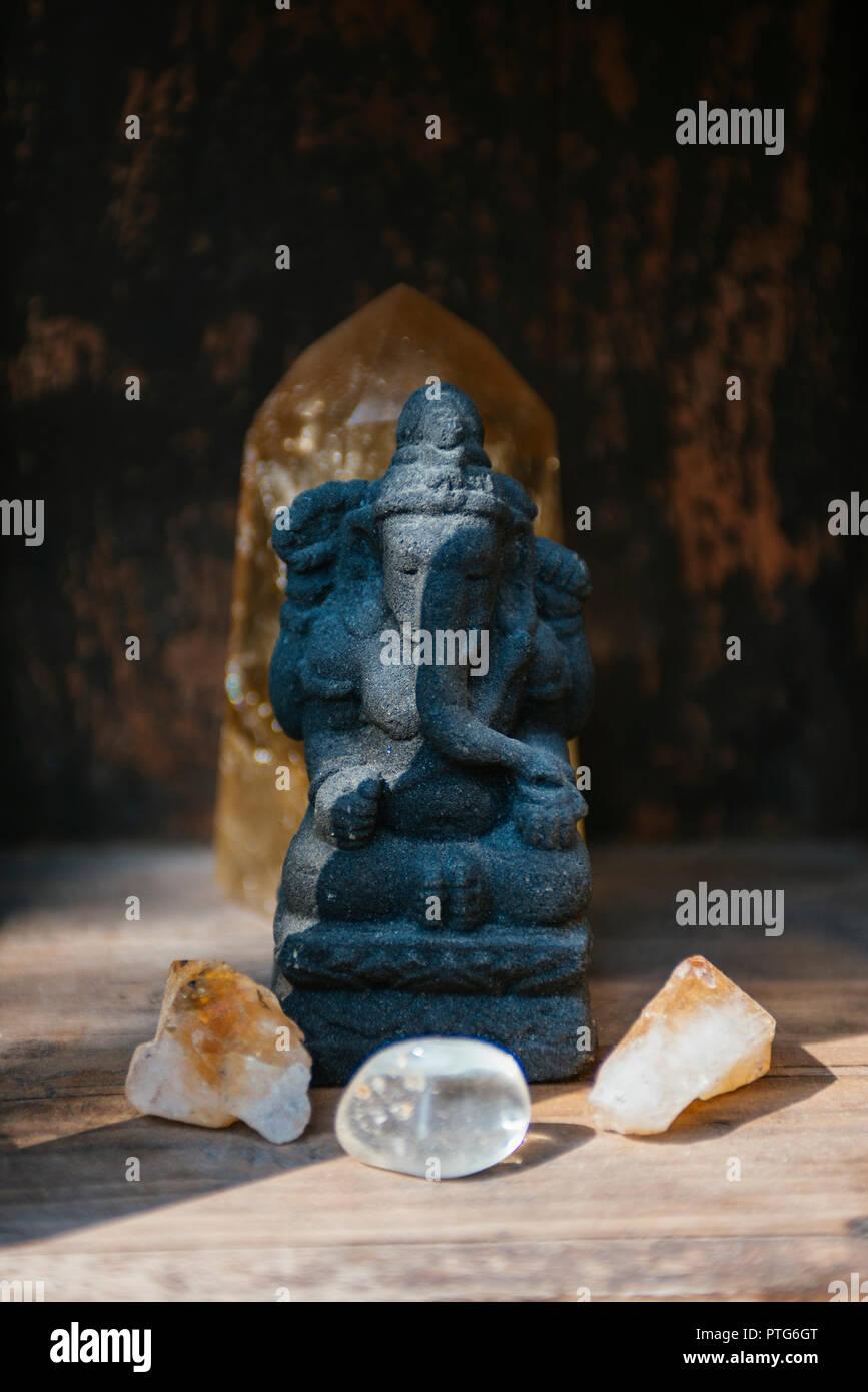 Garden Ganesha shrine with crystals - Stock Image