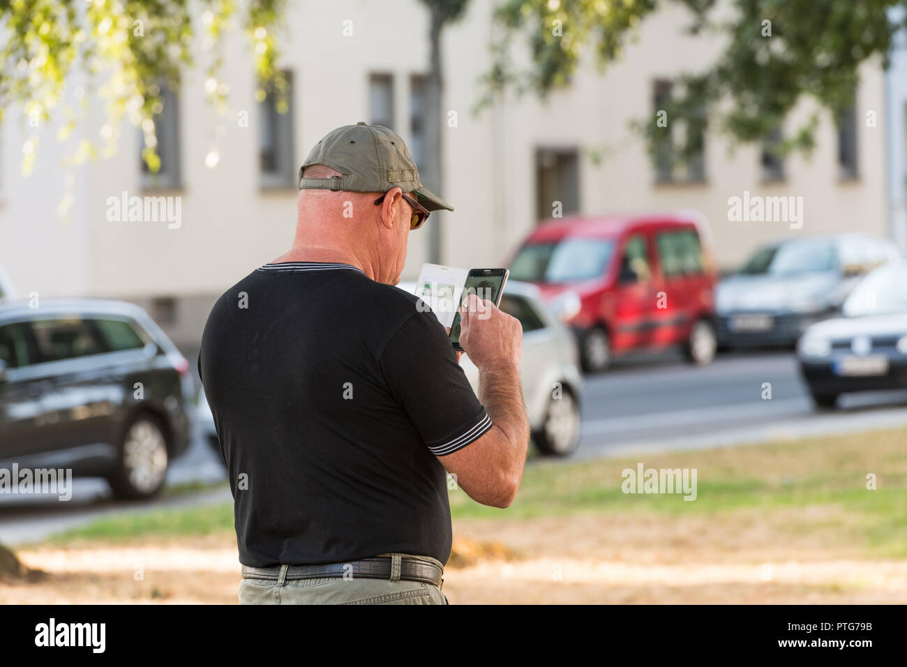 Man With Cell Phone Tablet Stock Photo