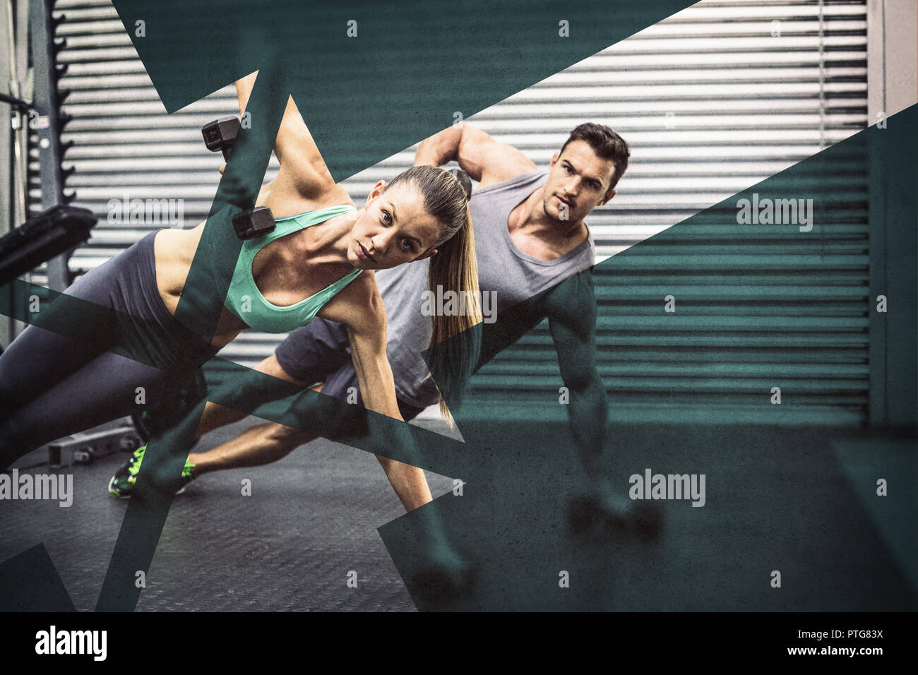 Smiling muscular couple doing side plank - Stock Image